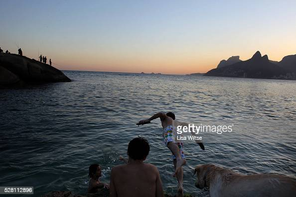 Tourists and locals plays on the rocks at Arpoador beach in Rio de Janeiro Brazil July 10 2010 Photo by Lisa Wiltse