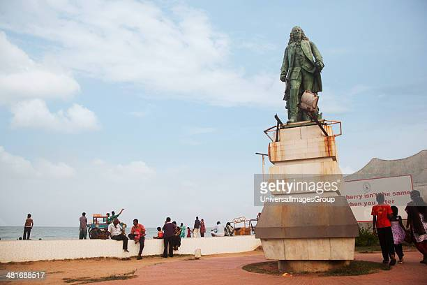 Tourists and monument on beach Pondicherry India
