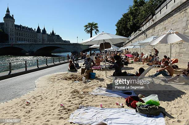 Tourists and Parisians take advantage of 'Paris Plage' an artificial beach set up on the right bank of the Seine river on August 1 2013 in Paris...