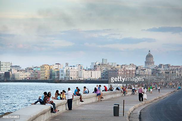 Tourists and Residents Enjoying the Malecón of Havana Cuba