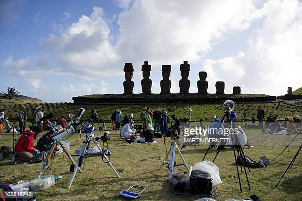 Tourists and scientists prepare their equipment before a solar total eclipse on Easter Island700 km off the Chilean coast in the Pacific Ocean on...