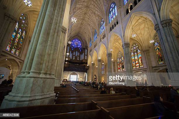 Tourists and worshippers sit in pews at Saint Patrick's Cathedral during a massive restoration effort in New York US on Tuesday April 7 2015 The $180...