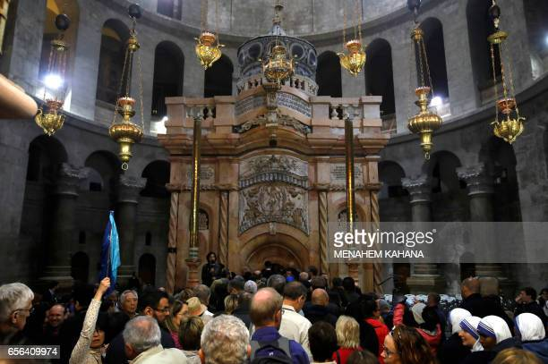 Tourists and worshippers wait to access the newly restored Edicule following a ceremony at the Church of the Holy Sepulchre traditionally believed to...