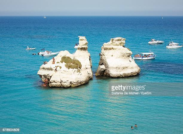 Tourists And Yachts Near Rock Formations In The Sea