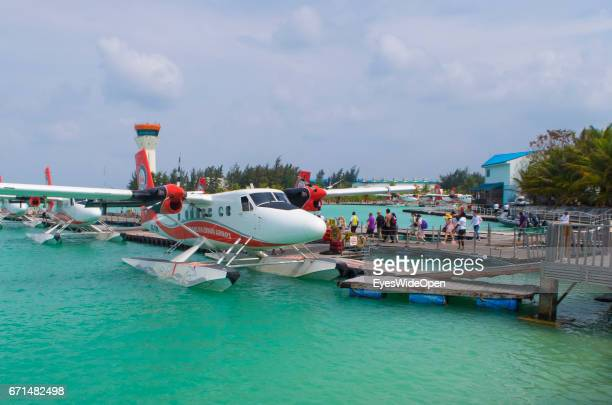 Tourists are boarding at a Seaplane of Trans Maldivian Airways at the Seadrome of Malé International Airport on February 20 2017 in Male Maldives