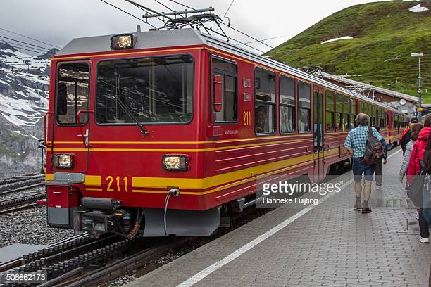 Tourists are boarding the Jungfraubahn which will take them from Kleine Scheidegg to Jungfraujoch the highest railway station in Europe at 3454 m...