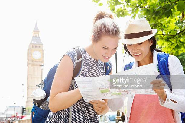 Tourists are checking map, Big Ben in background