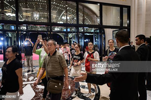 Tourists are let into the main entrance after the opening of the Sands new mega resort The Parisian in Macau on September 13 2016 Billionaire casino...