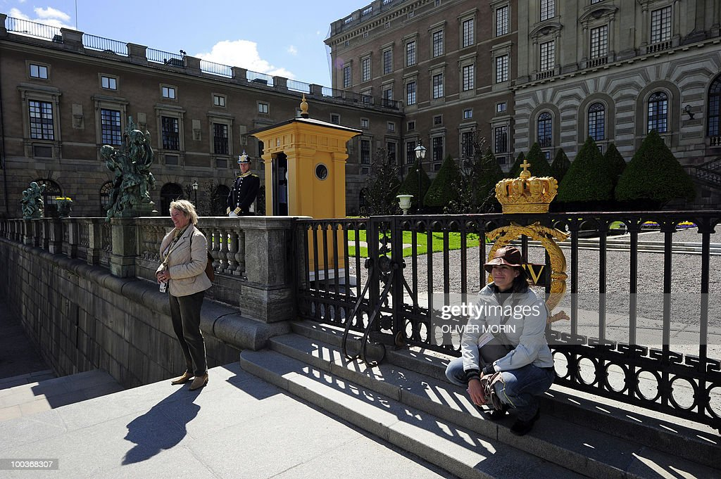 Tourists are photographed in front of the Royal Castle in Stockholm on May 24, 2010, where the royal wedding will be held. Many tourists paid a visit to the Swedish capital less than a month before Crown Princess Victoria 's wedding, the 32-year-old eldest daughter of King Carl XVI Gustaf.