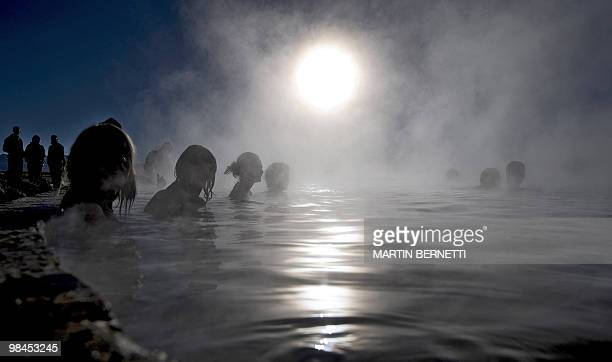 Tourists are seen bathing in hot springs near the small village of Agua Brava more than 4000 meters above sea level in the Uyuni salt flats Potosi...