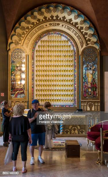 Tourists are seen by a beer glasses display at Museum of Beer bar and restaurant in Praca do Comercio on October 21 2017 in Lisbon Portugal Although...