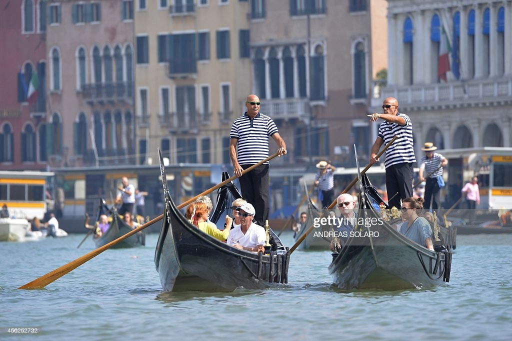 Tourists are seen on gondolas on the Grand Canal on September 28 2014 in Venice where US actor George Clooney and British fiancee Amal Alamuddin...