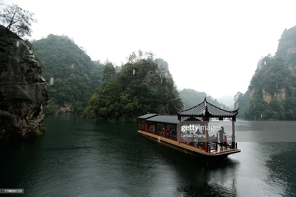 Tourists are seen on sightseeing cruises at the Baofeng Lake on September 1, 2013 in Zhangjiajie, China. Zhangjiajie National Forest park is a popular tourist destination in the Hunan province, home to striking sandstone and quartz cliffs and famously known for renaming a peak after the mountain formations inspired the fictional world of 'Pandora' in James Cameron's film, 'Avatar'.