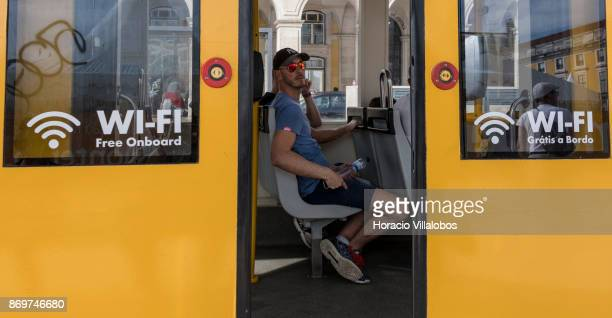 Tourists are seen riding on the E15 line tram connecting Praca da Figueira with Alges in Praca do Comercio on October 21 2017 in Lisbon Portugal E15...