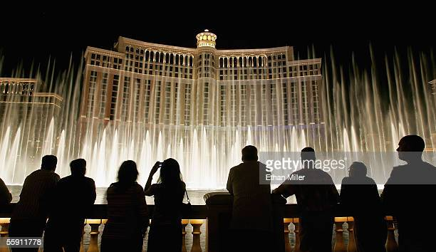 Tourists are silhouetted as they watch the Bellagio fountain show on the Las Vegas Strip October 12 2005 in Las Vegas Nevada