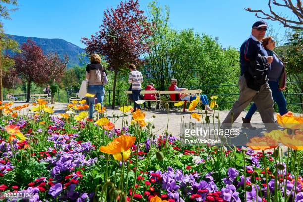 Tourists are walking next to flowers in the green city centre of Meran in South Tyrol on April 21 2015 in Lana Italy