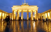 Tourists are walking through Berlin's landmark Brandenburg Gate across Parisian Square on October 5 2002 After having been restaurated for more than...