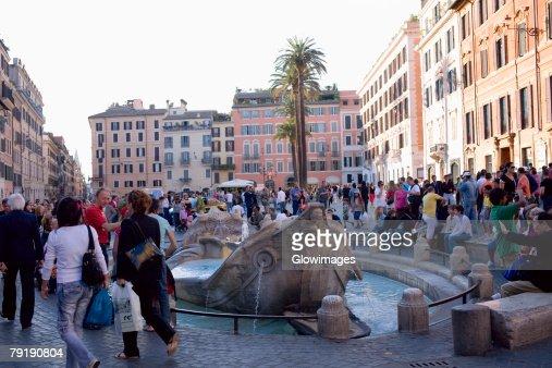 Tourists around a fountain, Piazza di Spagna, Rome, Italy : Stock Photo