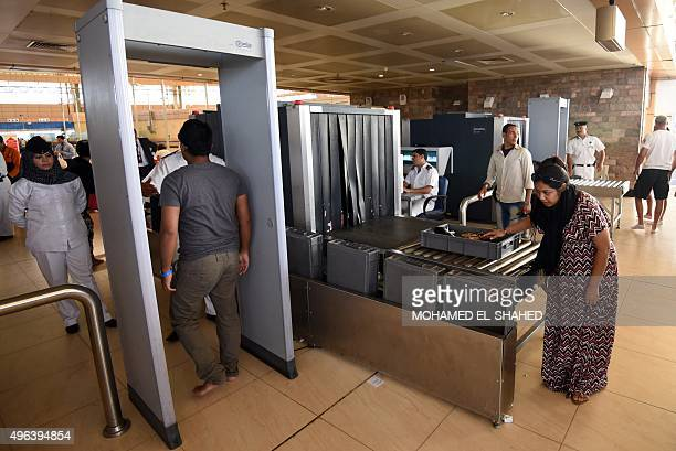 Tourists arrive at the airport in Egypt's Red Sea resort of Sharm ElSheikh on November 9 2015 Tens of thousands of Russians and Britons were being...