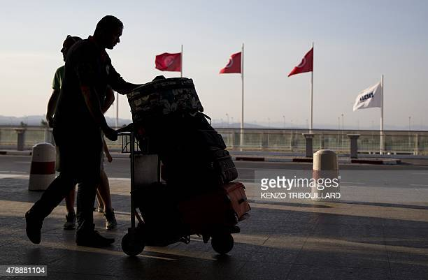 Tourists arrive at the Enfidha International airport on June 28 to leave Tunisia two days after a shooting attack on the Riu Imperial Marhaba Hotel...