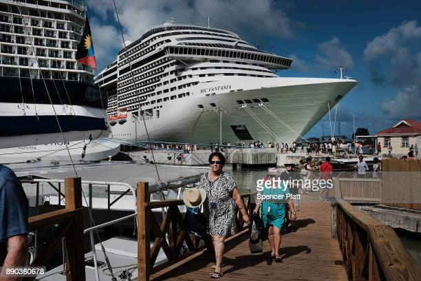 Tourists arrive from a cruise ship in St John's on December 11 2017 in St John's Antigua While its sister island of Barbuda was nearly destroyed in...