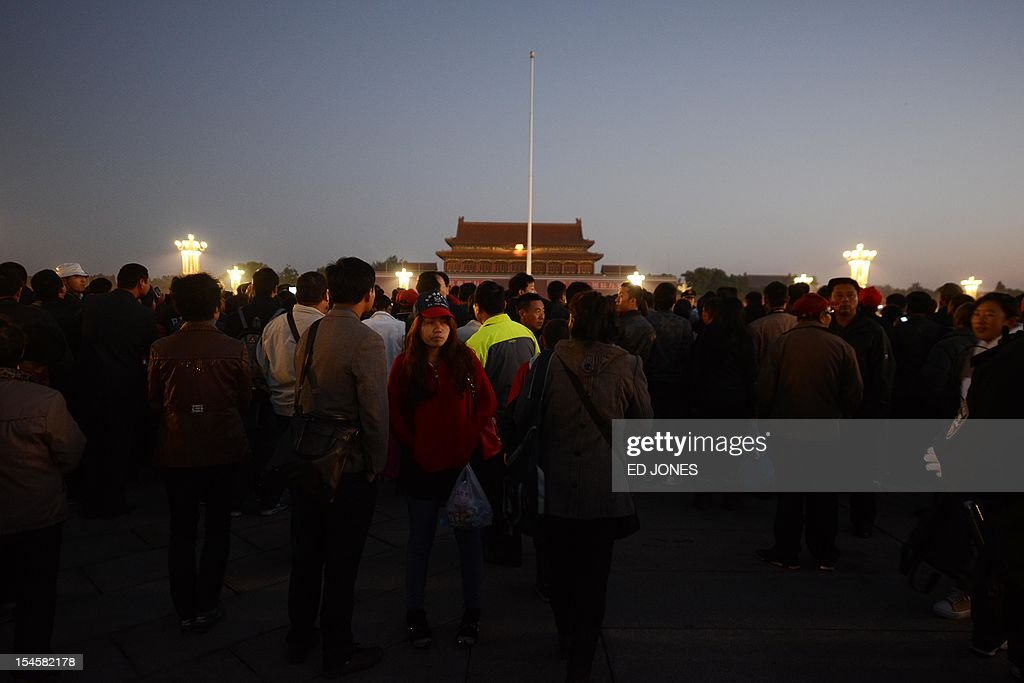 Tourists arrive on Tiananmen Square to watch the daily flag-raising ceremony early on October 23, 2012. Supporters of disgraced politician Bo Xilai have published a letter on a leftist website urging him not to be expelled from China's parliament which would pave the way for him to face trial over alleged corruption and charges. AFP PHOTO / Ed Jones