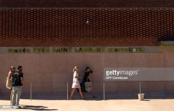 Tourists arrive to visit the new Yves Saint Laurent museum in the Moroccan city of Marrakesh on October 19 2017 A fusion of the Moroccan traditions...