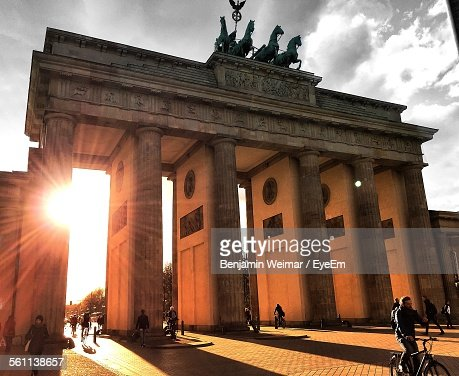 Tourists At Brandenburg Gate Against Sky