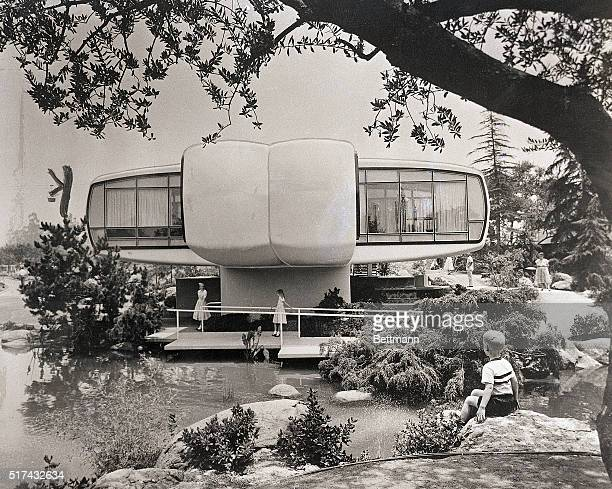 Tourists at Disneyland tour a plastic 'house of the future' built by Monsanto Chemical Company