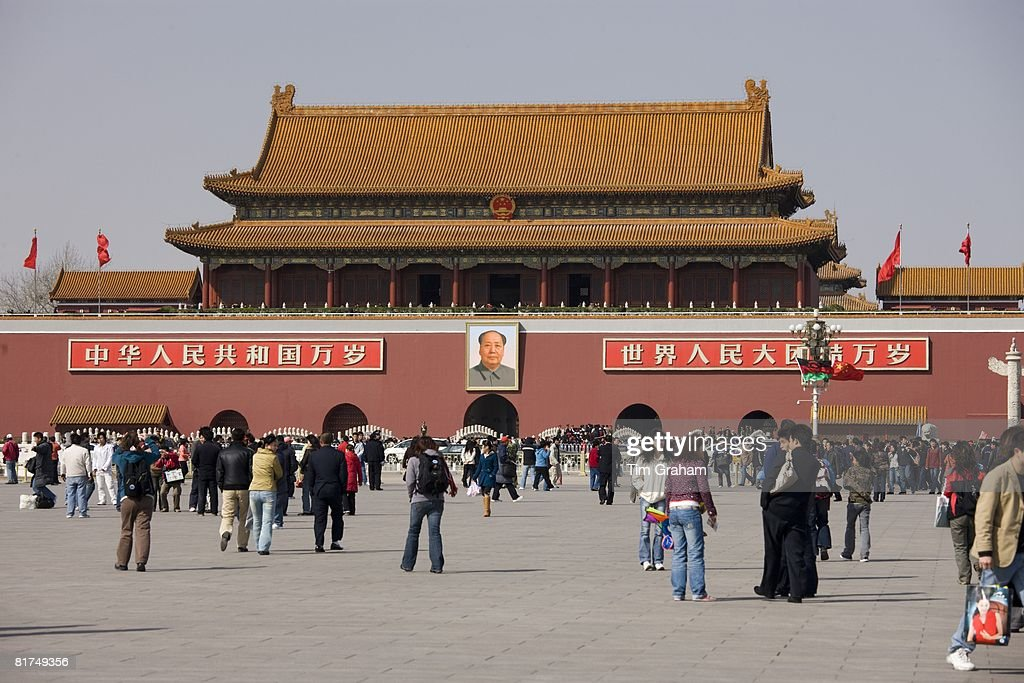 Tourists at Gate of Heavenly Peace with Chairman Mao's portrait Entrance to the Forbidden City Beijing China