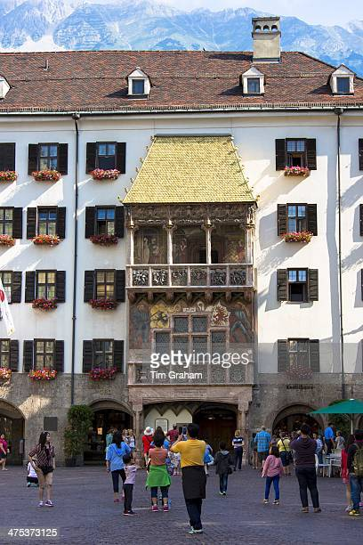 Tourists at Goldenes Dachl Golden Roof built 1500 of gilded copper in Herzog Friedrich Strasse Innsbruck the Tyrol Austria