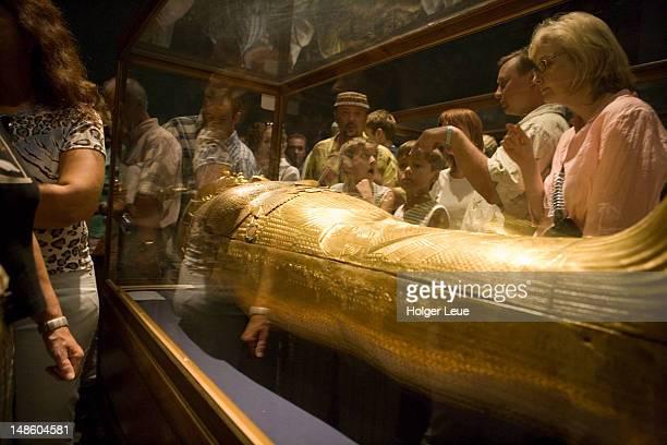 Tourists at mummy exhibit, Eqyptian National Museum.