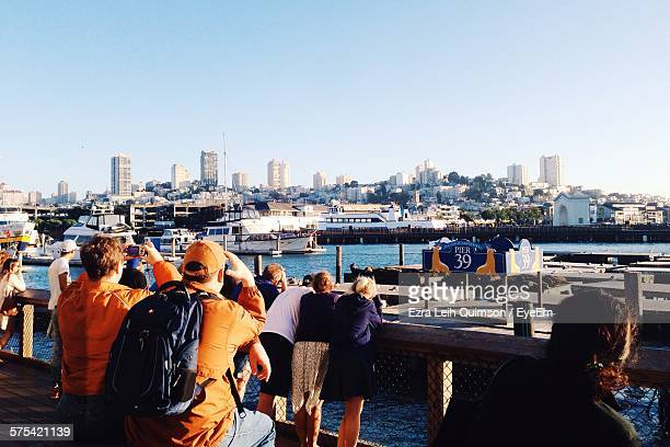 Tourists At Pier 39 Against Clear Sky
