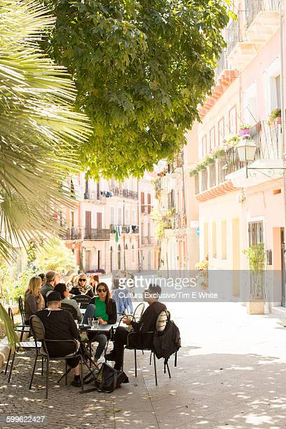 Tourists at sidewalk cafe in town square, Cagliari, Sardinia, Italy
