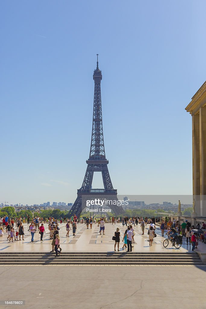 Tourists at the front of Eiffel Tower, Paris