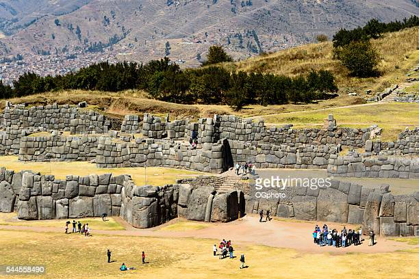 Tourists at the Incan archaelogical site of Saqsaywaman, Cusco, Peru