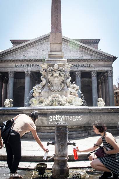 Tourists at the Nasone fountain In the face of drought the possibility to close or reduce the flow of water of the 'Nasone' the historical fountains...