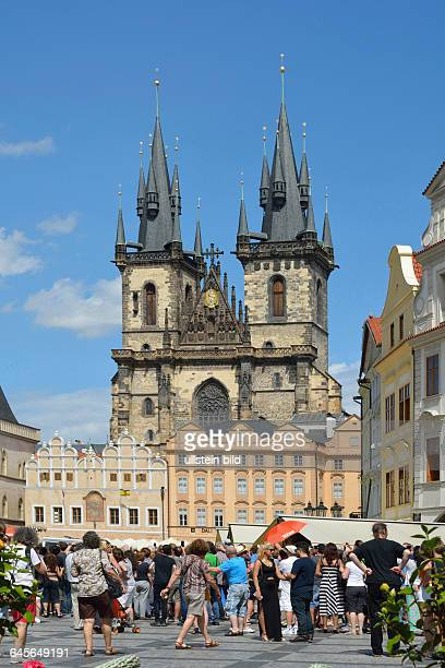 Tourists at the Old Town Square in front of the Church of Our Lady before Tyn of Prague in the Czech Republic