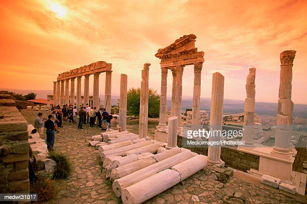 Tourists at the ruins of the Temple of Trajan at sunset in Pergamon, Bergama, Aegean region, Turkey