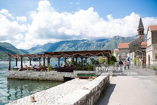 Tourists at waterfront restaurant near Perast, Montenegro