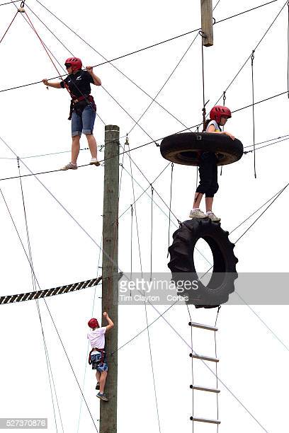 Tourists attempt the challenge at Rock'n'Ropes climbing course Taupo New Zealand 6th January 2010 Photo Tim Clayton