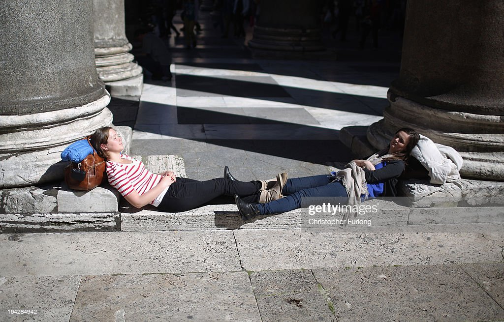 Tourists bask in the sun outside The Pantheon on March 22, 2013 in Rome, Italy. Newly elected Pope Francis and the Vatican are preparing for the new pontiff's first Easter week which will incorporate the pope washing the feet of prisoners in a youth detention centre in Rome next Thursday.