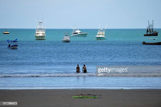 Tourists bath in San Juan del Sur beach 140 km from Managua during the tsunami alert issued in the Pacific coast following the earthquake that...