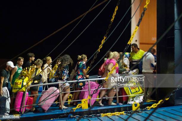 TOPSHOT Tourists board a ferry early morning in Ischia on August 22 after an earthquake hit the popular Italian tourist island off the coast of...