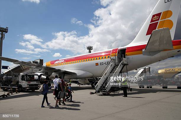 Tourists boarding Iberia Airbus A321
