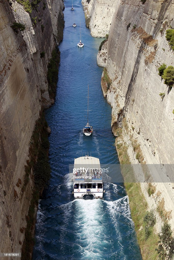 Tourists boats and yachts pass through the Corinth canal near Corinth, Greece, on Monday, Sept. 23, 2013. While the country's lenders are on firmer footing after getting capital from euro-area and International Monetary Fund bailout funds, they still need to reduce the non-performing loans that have tripled to 29 percent of the total in three years and threaten their new-found solvency. Photographer: Kostas Tsironis/Bloomberg via Getty Images