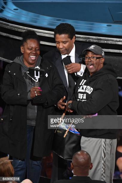 Tourists brought into the Oscars as a surprise meet with nominee for Best Actor in 'Fences' Denzel Washington at the 89th Oscars on February 26 2017...