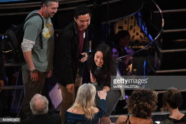 Tourists brought into the Oscars as a surprise meet with US actress Meryl Streep at the 89th Oscars on February 26 2017 in Hollywood California / AFP...