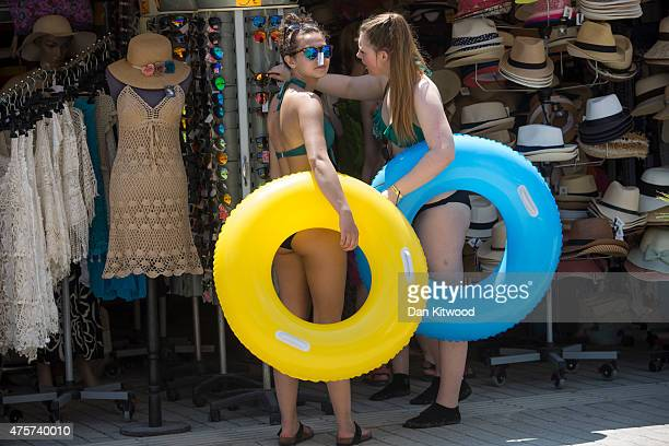 Tourists buy rubber rings in a shop on June 03 2015 in Kos Greece The Island has recently seen a drop in tourist numbers which has been attributed to...