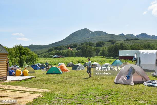 Tourists camp near Kurile Lake on the southern tip of the Kamchatka Peninsula in Russia on July 20 2017 Home to around 500 wild bears the area around...